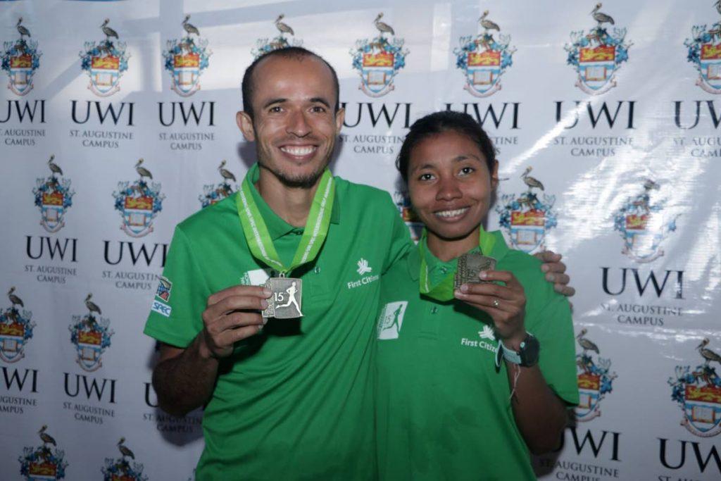 Winners of the 2018 UWI SPEC Half Marathon Didimo Armando Sanchez of Venezuela (left) and Raquel Agudelo Berrio of Colombia. PHOTO COURTESY UWI SPEC. -