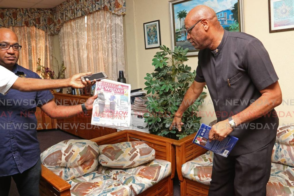 OWTU president general Ancel Roget reads Newsday's front page, last Thursday, on Opposition MP Dr Roodal Moonilal's call for an investigation of the union's acquistion of the Pointe-a-Pierre refinery. FILE PHOTO BY MARVIN HAMILTON  -