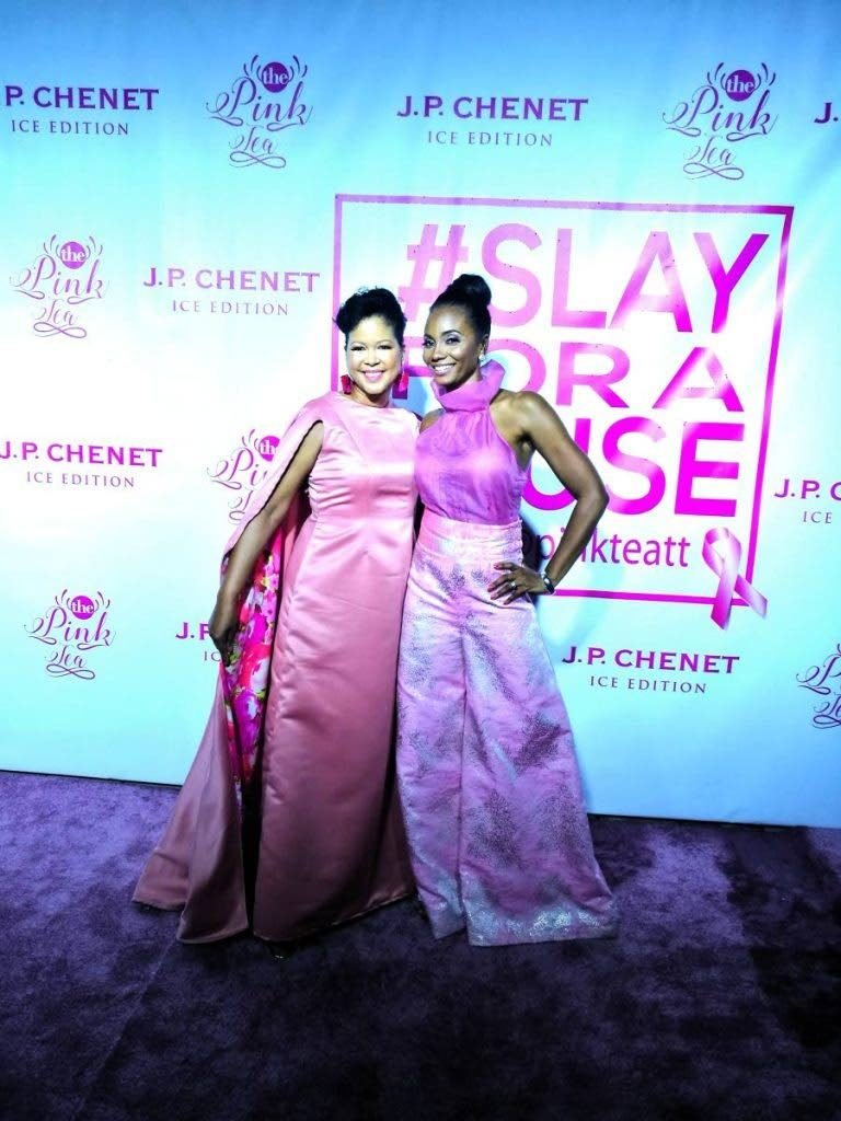 Pink Tea TT 2017: Keisha Butcher and organiser/host of Pink Tea TT, Danielle Jones-Hunte, pose for photos on the pink carpet of the second annual event, held at Chaud Cafe, One Woodbrook Place, St James in October 2017. -
