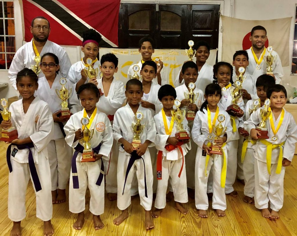 The winners of the various categories with their medals and trophies. -