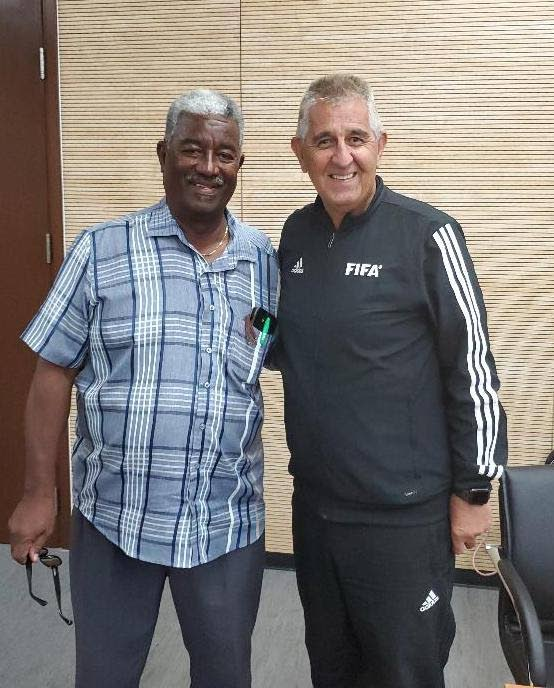 FIFA Referees technical instructor Esse Baharmast (right) with TTFA Refereeing Department head Wayne Caesar during the recent RAP course. PHOTO COURTESY TTFA. -