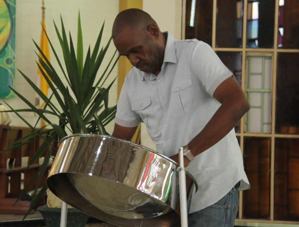 PLAY ONE FOR 'TICO': Duvone Stewart plays Memories by the Mighty Sparrow (Slinger Francisco) yesterday at the funeral for masman Brian 'Tico' Skinner at the St Theresa's RC Church in Malick.  PHOTO BY AYANNA KINSALE