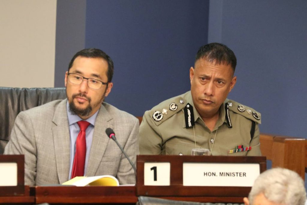 MINISTER AND FORMER MINISTER: National Security Minister Stuart Young and former security minister now Commissioner of Police Gary Griffith at the Parliament's Standing Finance Committee meeting yesterday. PHOTO COURTESY OFFICE OF THE PARLIAMENT -