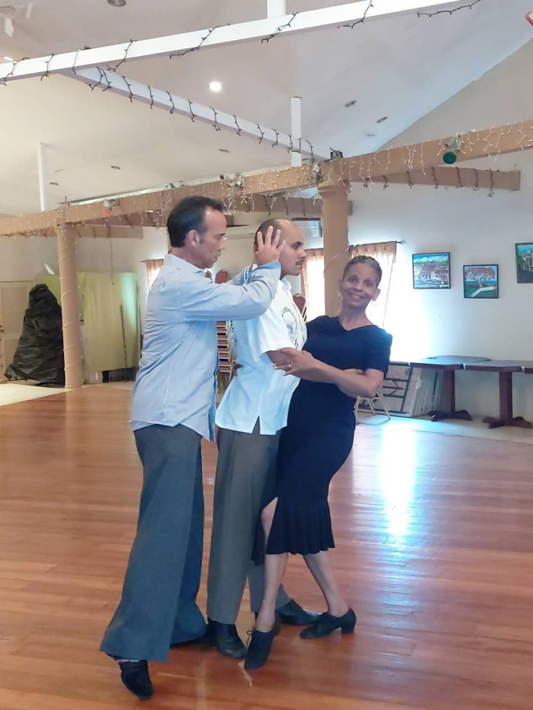 Alec Lazo, left, a US-based ballroom dancer and examiner gives tips to instructors of Eugene Joseph's Trinidad Dance Theatre, Nickell Joseph and  Alicia Scoon. -