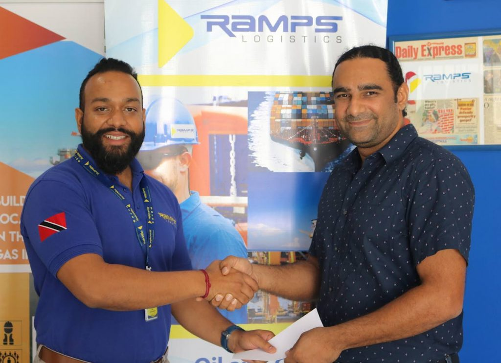 Operations Director at Ramps Logistics, Rudy Rampersad (left), presents Dr Akash Pooransingh of the UWI, St Augustine with a cheque for the title sponsorship of the Super Series Invitational T20 Tournament at his company's headquarters at Munroe Road, Chaguanas. -