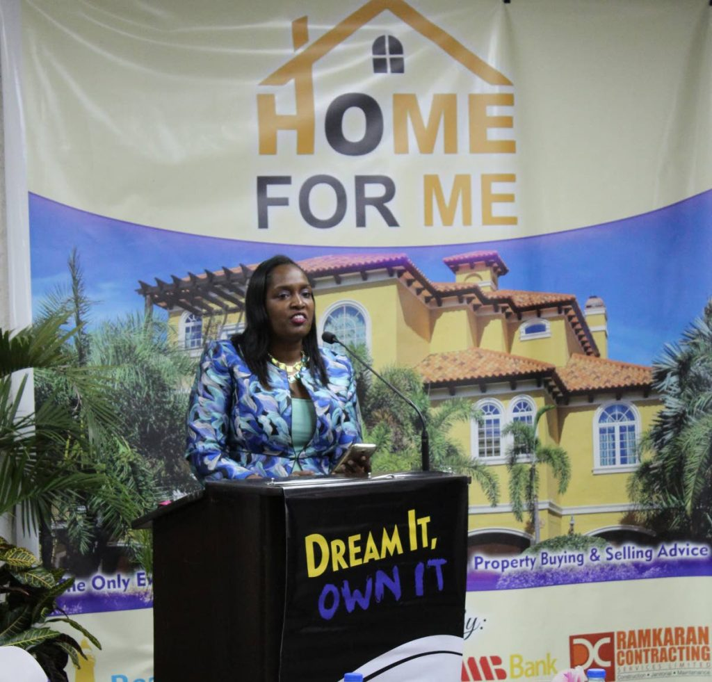 Patries Ramkaran, managing director of  Ramkaran Contracting Services Ltd, addresses the seminar Home For Me at the Chamber of Industry and Commerce, Westmoorings  in September. -