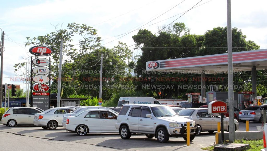 Drivers line up at this NP gas station at Eastern Main Road, Valencia on Tuesday. - ROGER JACOB