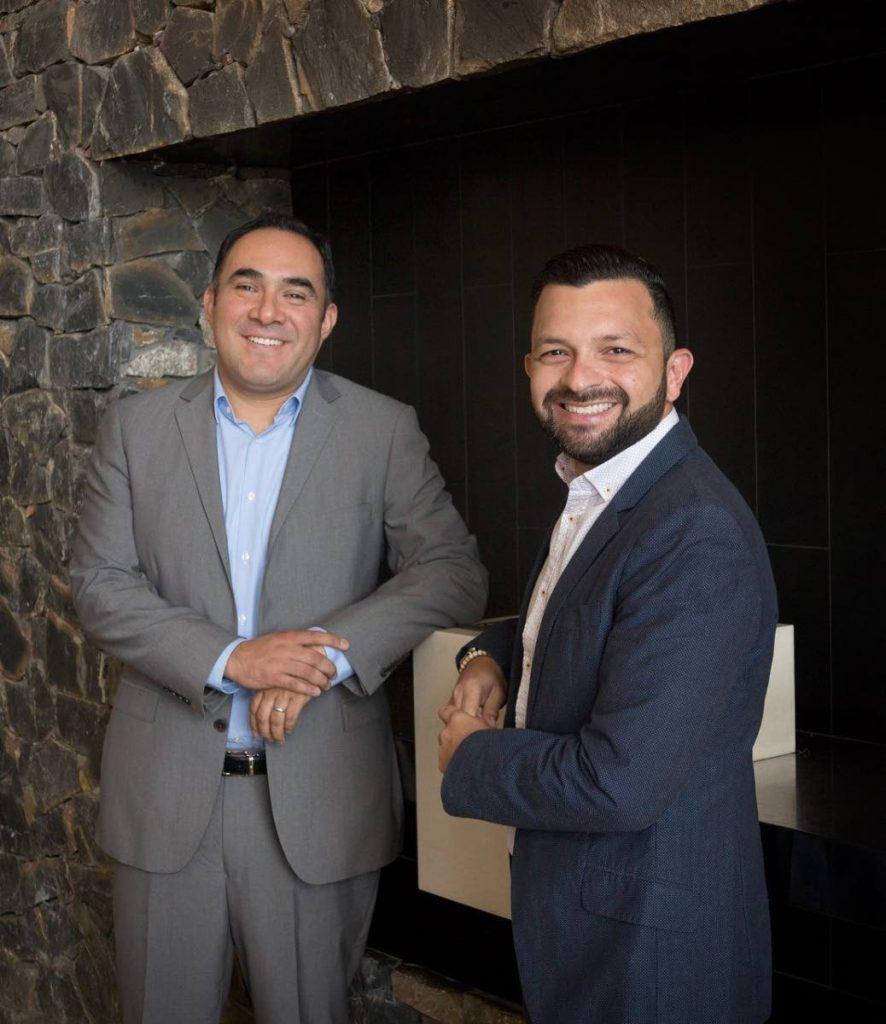 Gabriel Lopez and Julio Blanco Rey of Avaya. - Mark Lyndersay