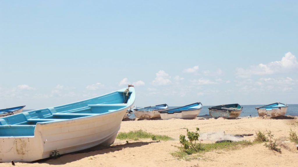 Boats along the shore at an Icacos beach.