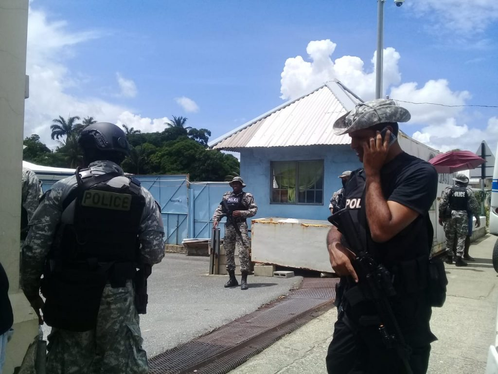 Police at the scene of a rescue operation in Arouca. Photo by Shane Superville.