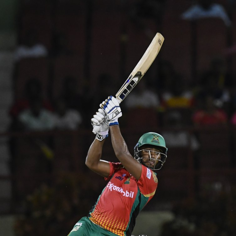 Guyana Amazon Warriors' Nicholas Pooran smashes a boundary against the Trinbago Knight Riders in a Hero CPL match at the National Stadium, Providence, last night. PHOTO COURTESY CPL T20 2019