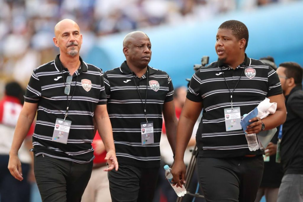 In this Nov 15,2016 file photo, ex-TT coach Stephen Hart, left, walks with his assistants Hutson Charles, centre, and Derek King,  after losing to Honduras.  -  Allan V. Crane/CA-images.