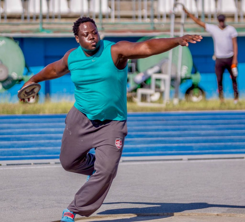 Akeem Stewart competes in the discus event at the NAAA Development Meet at the Dwight Yorke Stadium in Bacolet.  - DAVID REID