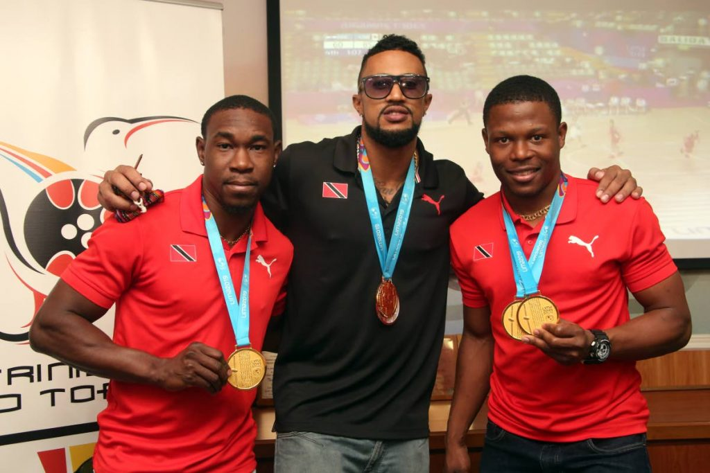 In this file photo, TT cyclists Keron Bramble, from left, Njisane Phillip and Nicholas Paul pose with their 2019 Pan American Games medals at the TT Olympic House in Port of Spain, on Aug 7. PHOTO BY SUREASH CHOLAI -