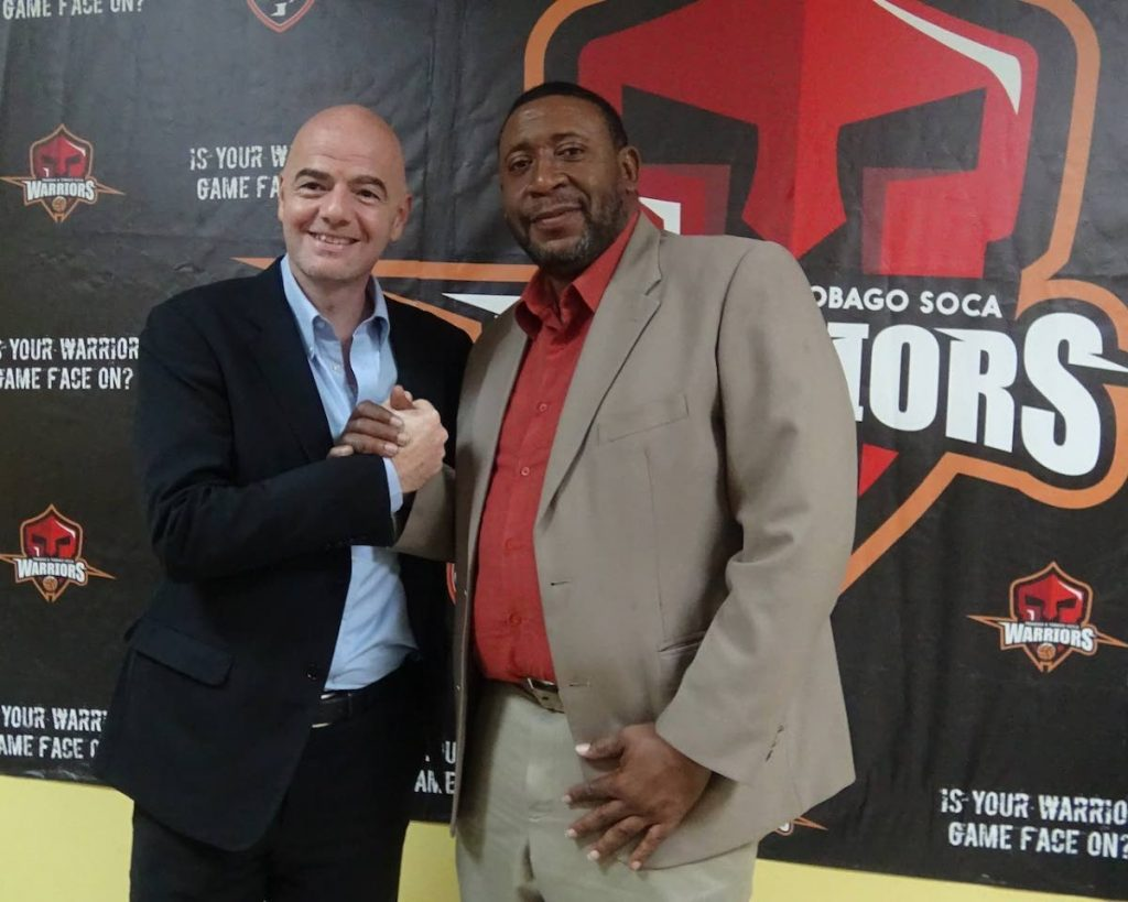 In this Jan 27,2016 file photo,TTFA president David John-Williams (right) shakes hands with FIFA presidential candidate Gianni Infantino at the TTFA office. Infantino will be at the opening of the Home of Football on Nov 18.  PHOTO COURTESY TTFA -