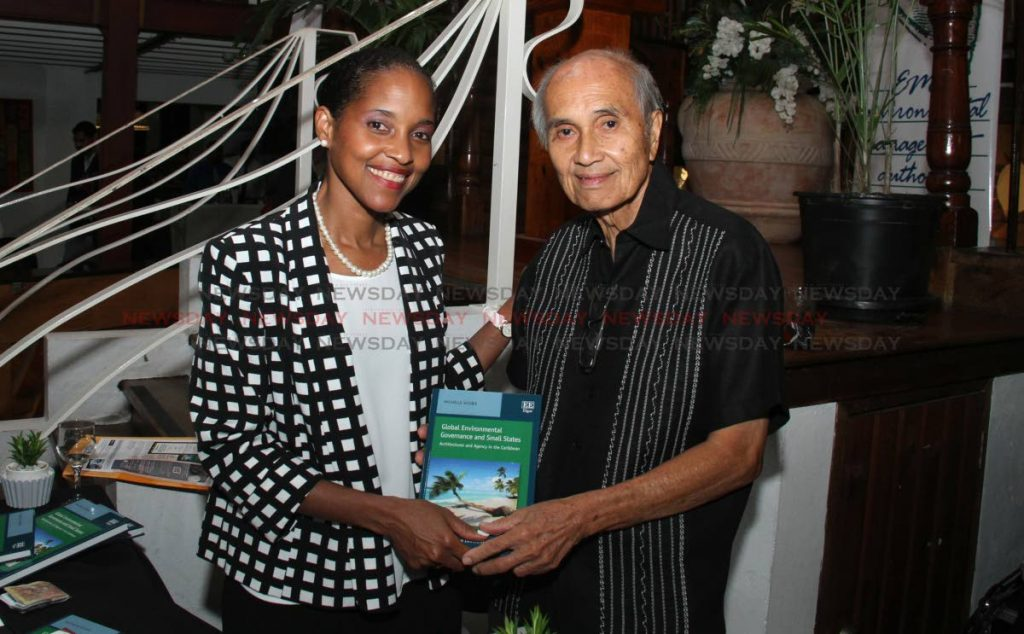 In this October 1 file photo, Dr Michelle Scobie presents a copy of Global Environmental Governance and Small States: Architectures and Agency in the Caribbean to Normandie Hotel managing director Fred Chin Lee during her book launch hotel. Chin Lee died on Sunday at age 84. - Ayanna Kinsale
