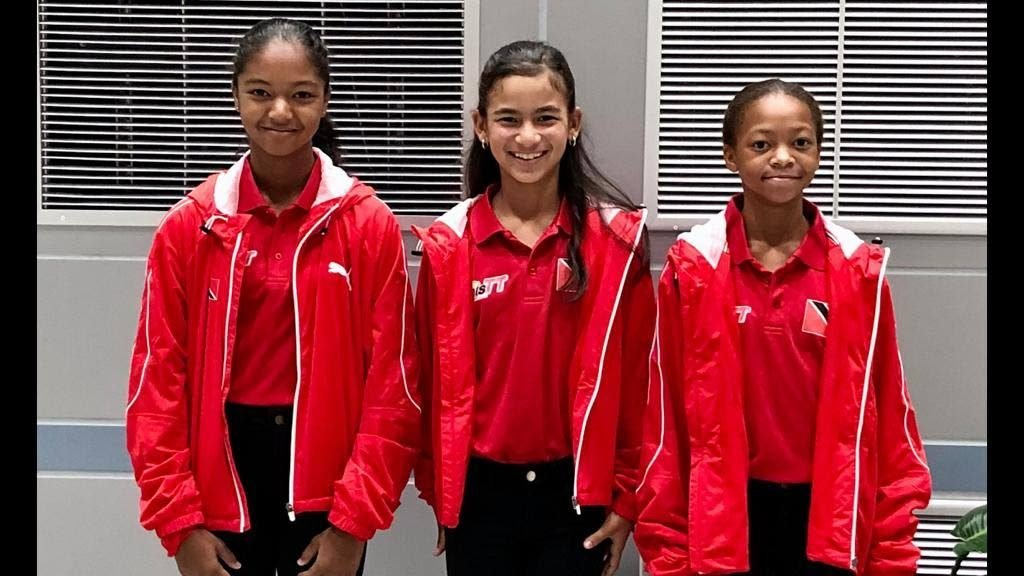 Cameron Wong, left to right, Jordane Dookie and Jaeda-Lee Daniel-Joseph at Piarco International Airport on their way to Bolivia for the 2019 Copa COSAT tournament, last month.  -