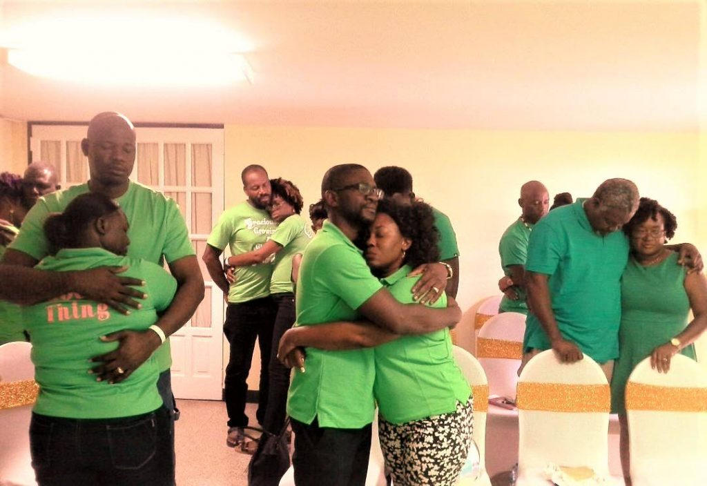 Couples hug each other to show their love during a seminar hosted by Committed Couples in Marriage last Saturday. -