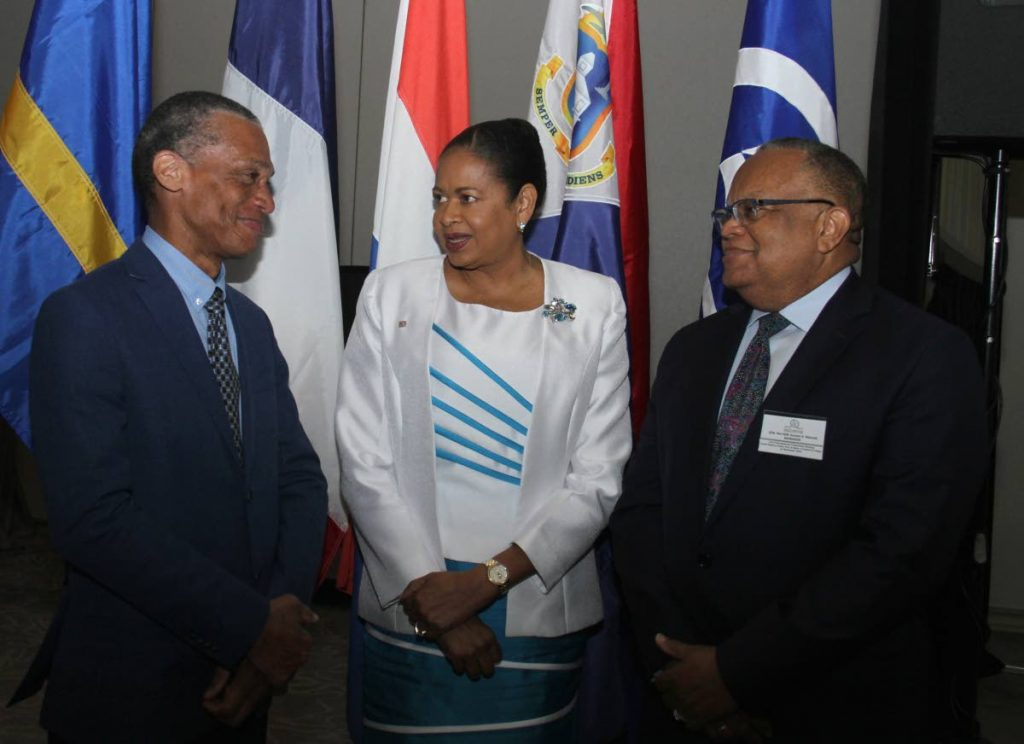 CHIT CHAT: Minister of Foreign and Caricom Affairs Dennis Moses (left) speaks with Association of Caribbean States secretary general Dr June Soomer, and Minister of Foreign Affairs and Foreign Trade of Barbados Dr Jerome Walcott at the Hyatt on Friday.  PHOTO BY AYANNA KINSALE - Ayanna Kinsale