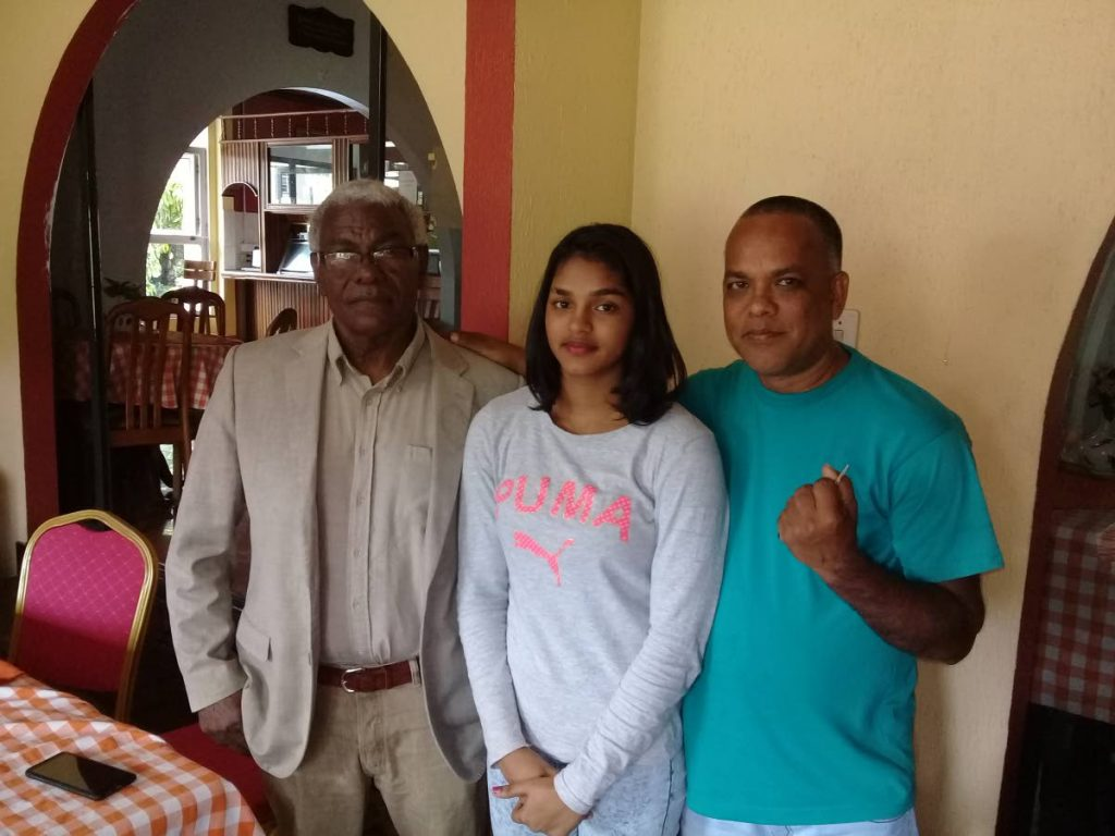 Boxing promoter Buxo Potts, from left, Faith Ramnath and her father Russell. - Jelani Beckles