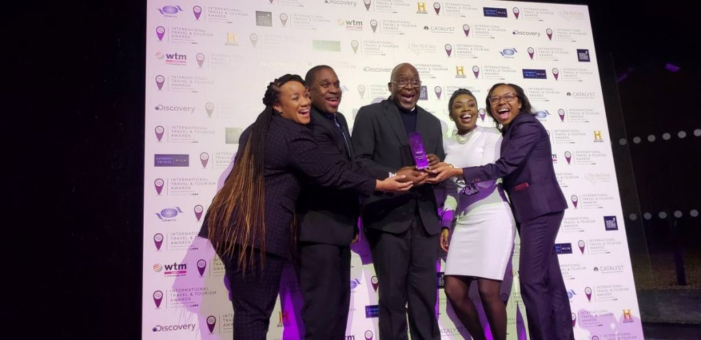 Chief Secretary Kelvin Charles, centre, with the silver award for Best National Tourism Board Campaign at the World Travel Market awards on Tuesday in London, England. Basking in the moment are Tobago Tourism Agency Ltd CEO Louis Lewis, second from left, Tourism Secretary Nadine Stewart-Phillips, second from right, and other members of the Tobago contingent.  - TTAL