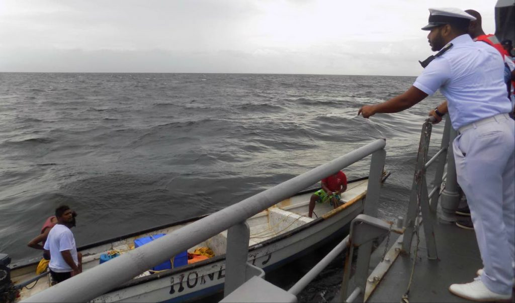Coast Guard officers interact with fishermen during a patrol in the Gulf of Paria on Wednesday. PHOTO BY SHANE SUPERVILLE  - Shane Superville