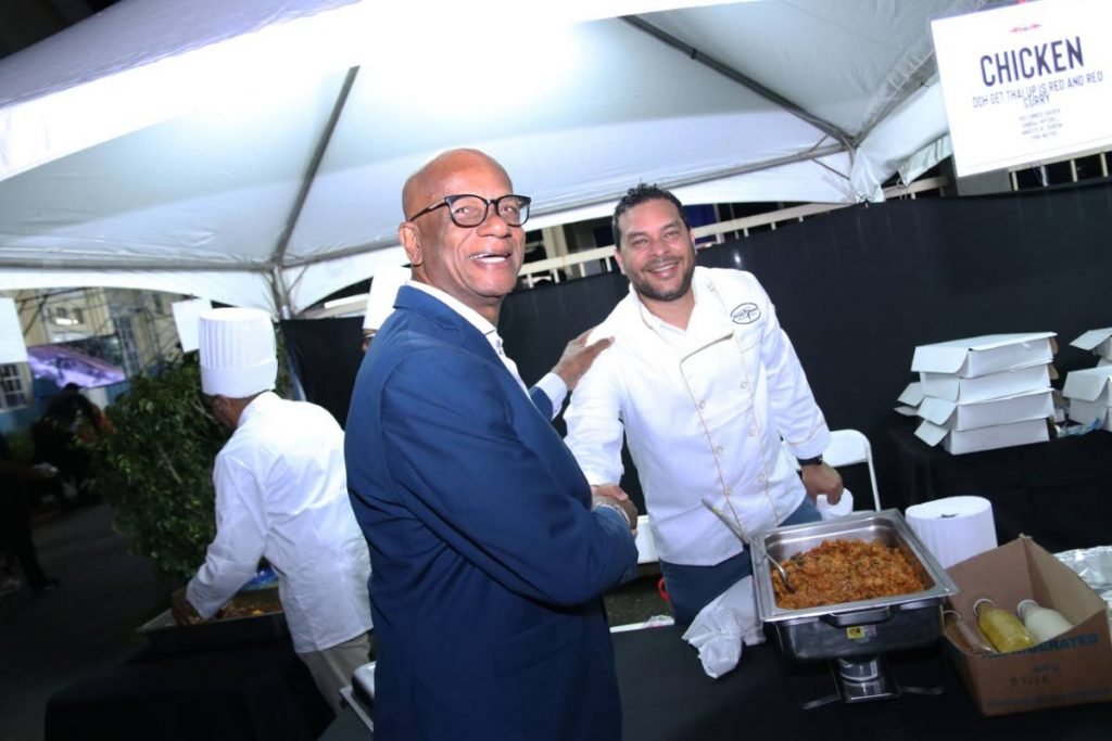 San Fernando Mayor Junia Regrello greets Minister of Tourism Randall Mitchell at  Southman Could Cook.  Mitchell prepared Doh Get Thai Up - Red Thai Curry.   -