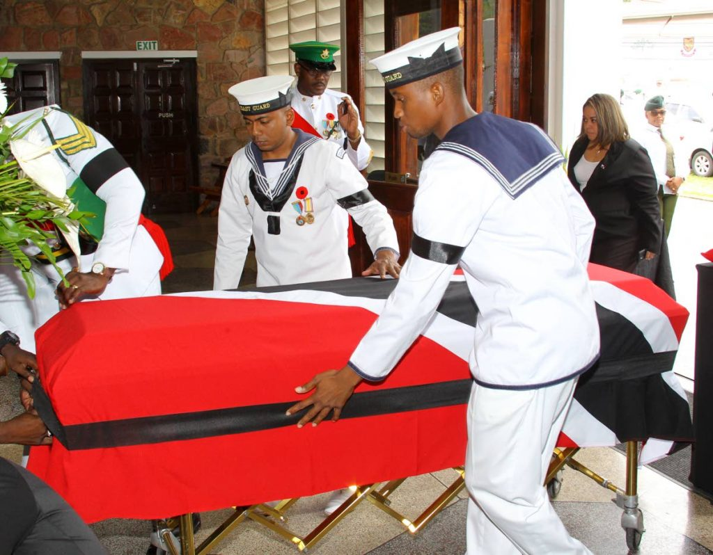 LAST TRIP: The flag-draped coffin is brought into the Church of the Assumption in Maraval for the funeral of former chief justice Clinton Bernard. PHOTO BY ROGER JACOB