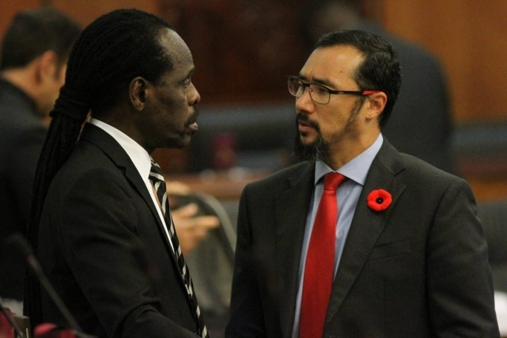 Minister of National Security Stuart Young, right, and Minister in the Ministry of the Attorney General Fitzgerald Hinds deep in conversation before the start of parliament yesterday.  - Angelo Marcelle