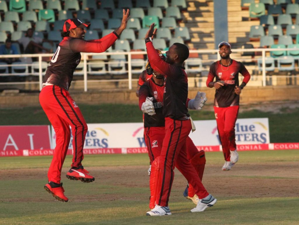 In this photo taken on Saturday, TT Red Force captain Imran Khan (L) celebrates with team-mates after the falling of a Guyana Jaguars wicket, during the Super50 match, at the Queen's Park Oval,St Clair. - Ayanna Kinsale