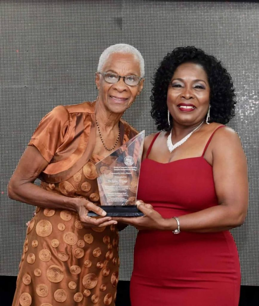 Former Senator Dr Eastlyn McKenzie, left, collects the inaugural icon award at the 2019 Community Champion awards held last Thursday. - THA