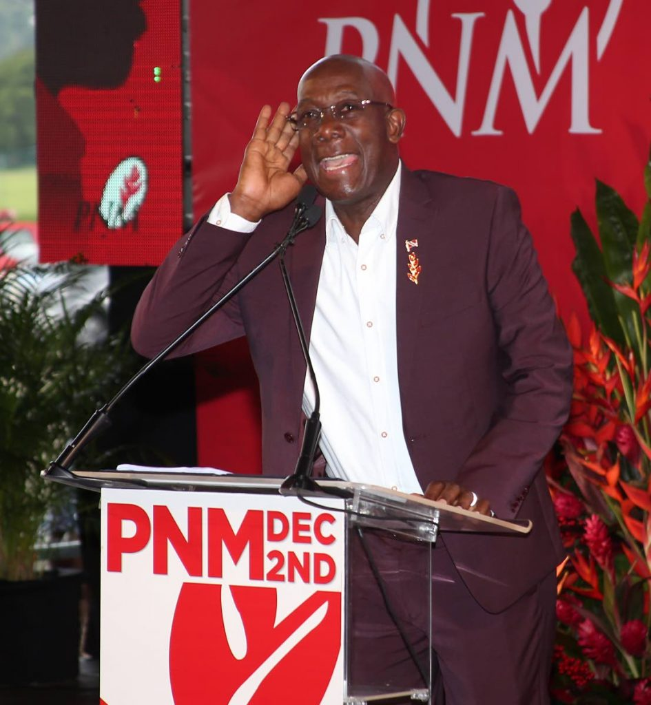 "LET ME HEAR YOU: Prime Minister Dr Keith Rowley calls on the PNM faithful to chant ""great is the PNM"" during his speech yesterday at the Queen's Park Savannah. PHOTO BY ANGELO MARCELLE -"