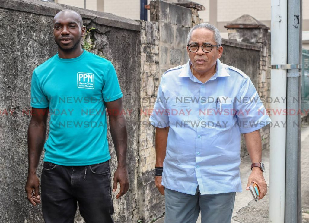 Port of Spain People's Movement (PPM) candidate for Belmont North and West Jerome Wilson and chairman Louis Lee Singh leave the EBC Office of the retuning officer Henry Street Port of Spain.  - JEFF K MAYERS