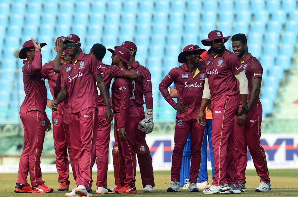 West Indies players cheer after taking a wicket against Afganistan during the third one day international (ODI), at the Ekana Cricket Stadium in Lucknow,yesterday. AFP PHOTO -