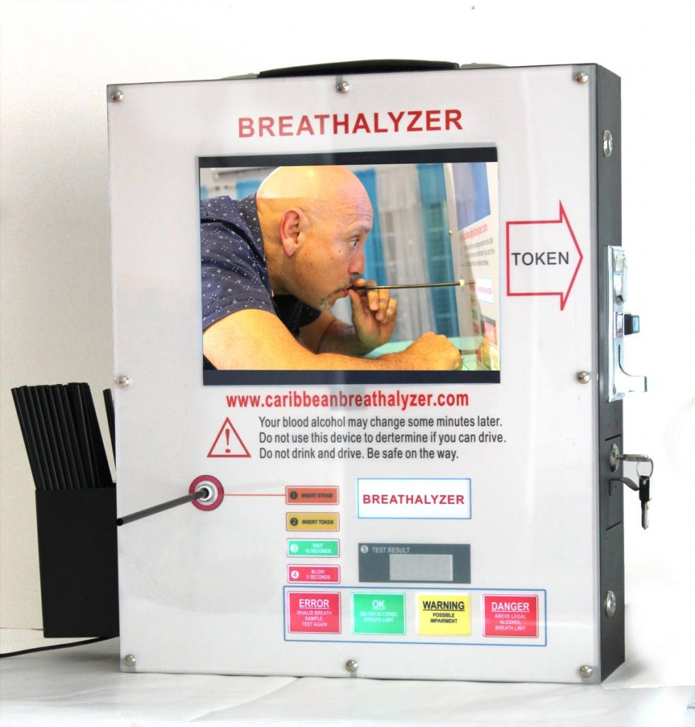 An in-place breathalyzer machine, which can be placed ay bars and other location. Using a token, a customer can purchase a single use breathalyzer kit from the machine. -