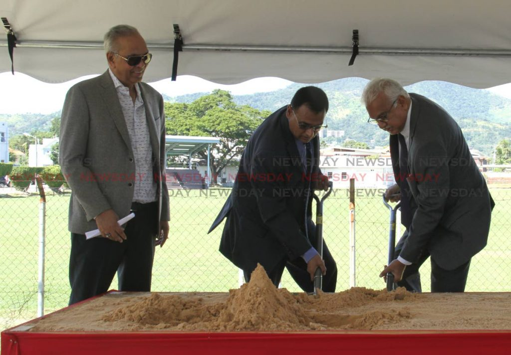 Minister of Works and Transport Rohan Sinanan, centre, and Minister of Health Terrence Deyalsingh, right, turn the sod for the pedestrian walkover near the Cipriani Labour College on Tuesday. Also in the photo is Contractor Junior Sammy.  - Ayanna Kinsale