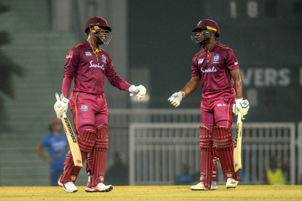 Evin Lewis, right, celebrates with team-mate Shimron Hetmyer after getting his half century during the first T20 international match at Ekana Cricket Stadium in Lucknow, today. Photo by Rohit Umrao/AFP  - ROHIT UMRAO