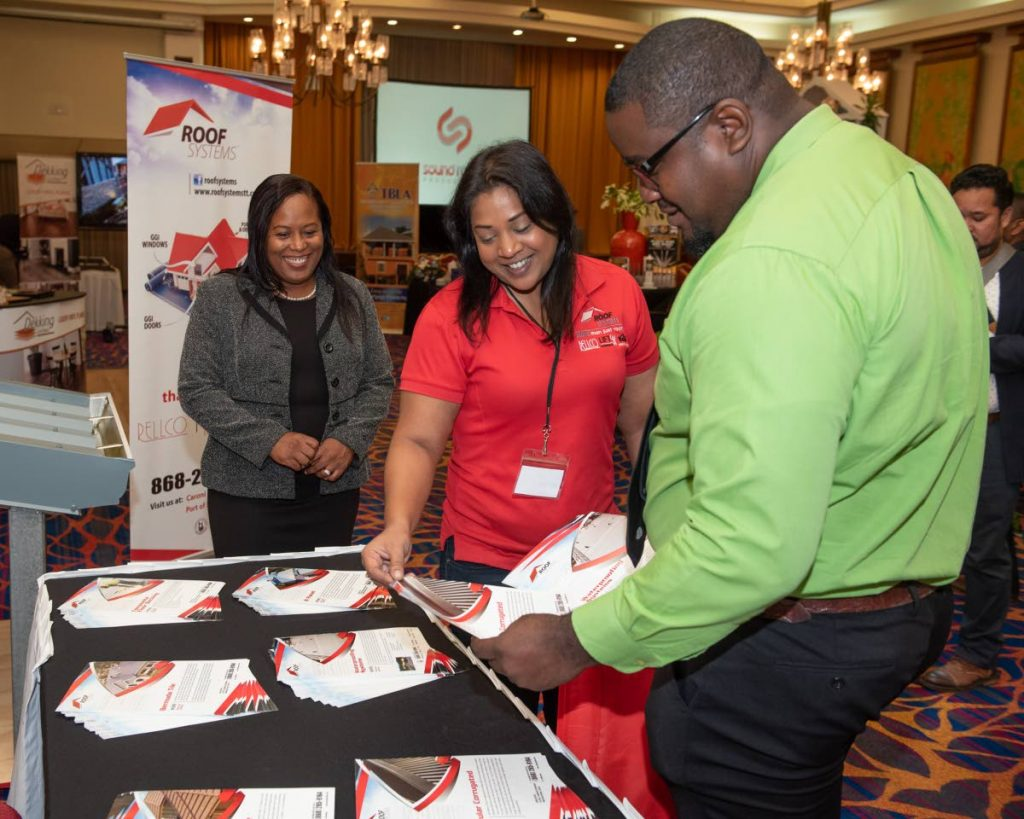 Sabina Ali of Roof Systems Ltd (centre) shares information with Port of Spain Deputy Hillan Morean at the House & Building Expo 2019 at Radisson Hotel, on Thursday. Looking on is Kaisha Kee A Ping-Alfred, CEO of Trendy Tradeshow Ltd. - Elliot Francois