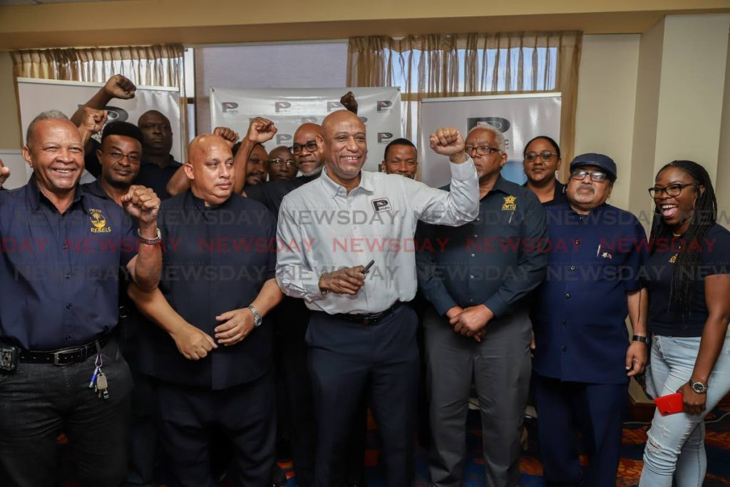 OWTU President General  Ancel Roget  poses with union members at the unveiling of the Patriotic Energies logo at the Radisson Hotel, Port of Spain.  - JEFF K MAYERS