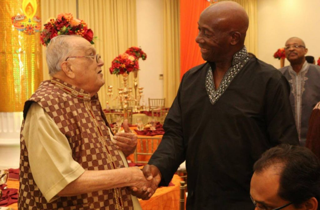 Prime Minster Dr Keith Rowley greets Maha Sabha secretary general Satnarayan Maharaj at a Divali function hosted by the Office of the Prime Minister. FILE PHOTO -