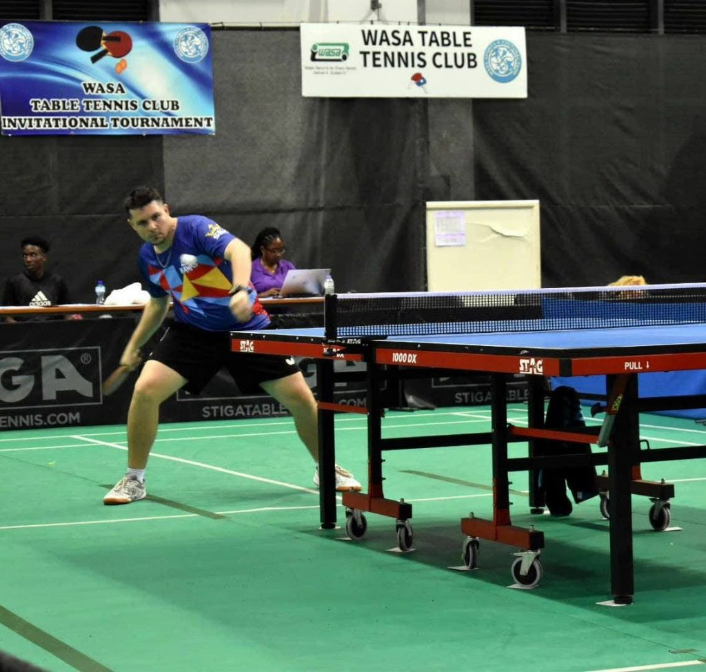 Sports Kings Hector Berrios, of Puerto Rico, hits a forehand shot against Young Veteran's Wayne Oudit,yesterday, on day two of the 2019 Wasa Invitational Table Tennis Tournament,at the National Racquet Centre,Tacarigua. - Sherdon Pierre