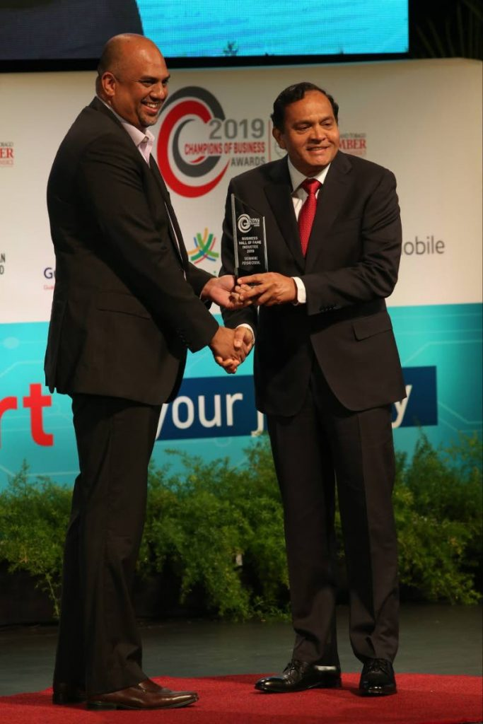 Sieunarine Coosal, chairman of the Coosal Group of Companies  receives the Business Hall of Fame award from Anand Pascal, president of Guardian Life at the TT Chamber of Industry and Commerce's Champions of Business awards ceremony, held at the National Academy for the Performing Arts, Port of Spain, Trinidad on November 15, 2019. - Angelo Marcelle