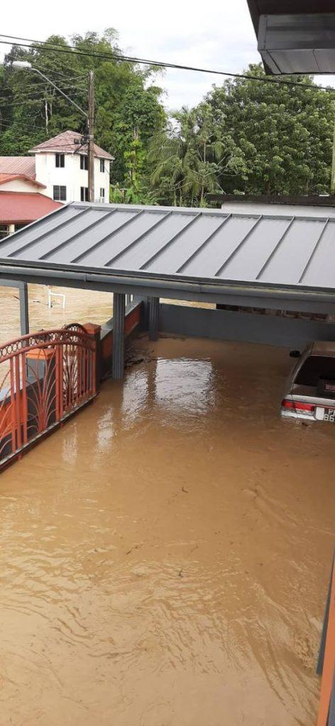 Flooding on Charles Street North, Gasparillo, Sunday. -