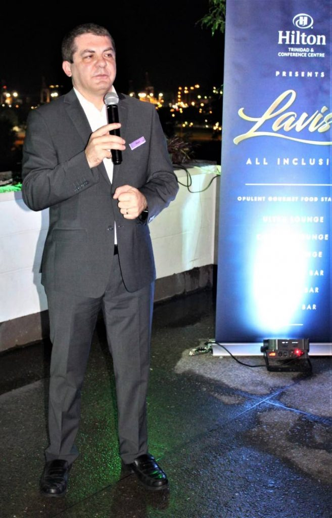 Hilton general manager Olivier Maumaire addresses guests at last Friday's launch of the hotel's all-inclusive Carnival fete Lavish at the Tea Terrace, St Ann's.  - Gary Cardinez