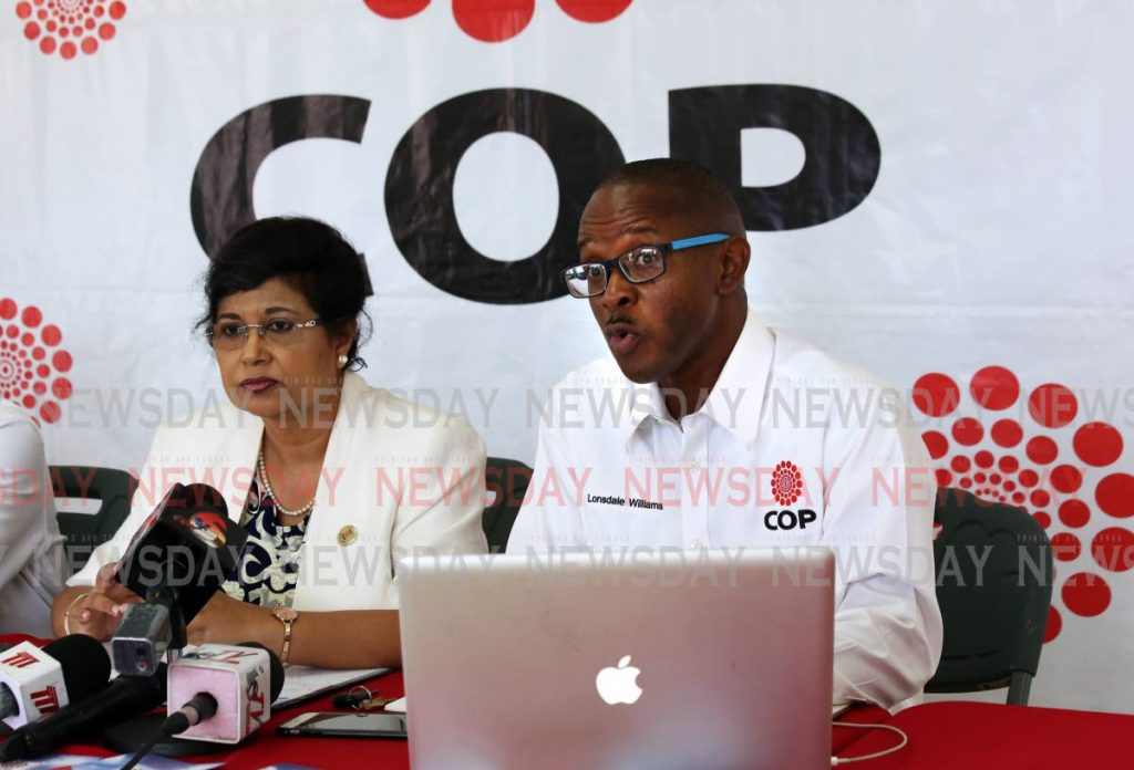 Congress of the People (COP) political leader Carolyn Seepersad-Bachan  (left) and  chairman of the Youth COP Lonsdale Williams speaking to media at their Curepe Regional office. - SUREASH CHOLAI