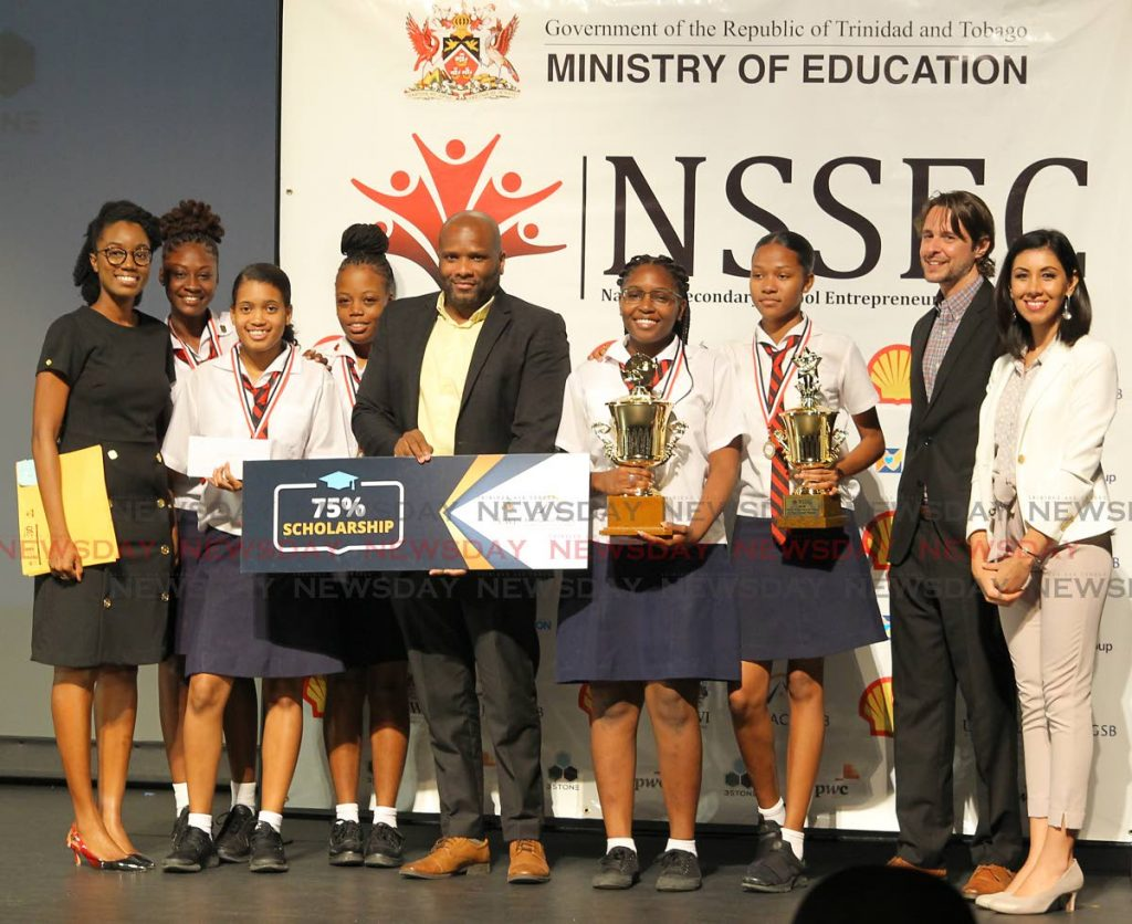 Bishop Anstey's Shanaryah Saunders, Imani Griffith, Jennika Lynch, Moesha Lynch, Javanna Glasgow and teacher Danielle Holder celebrate their victory as orverall winners of the National Secondary School Entrepreneurship 2019 competition at NAPA, Port of Spain on November 20.   Marcus McLeod of Arthur Lok Jack GSB, Sophia Stone and Christian Stone directors of 3Stone Research and Consulting Ltd presented the team with prizes. PHOTO BY ROGER JACOB.  - ROGER JACOB