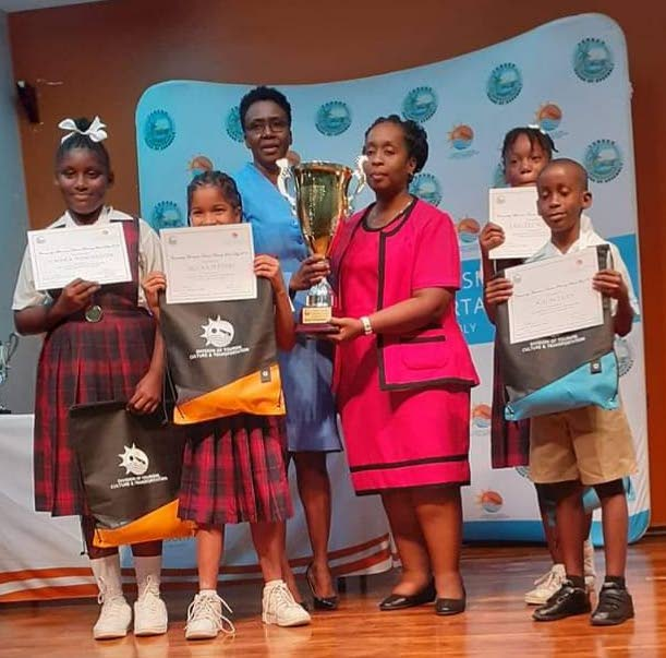 Penetecostal Light and Life Foundation team with their trophy and prizes for winning the schools tourism quiz hosted by the Division of Tourism, Culture and Transportation. Administrator Selma Graham, background, handed out the awards on Wednesday.  - Kieron McDougall