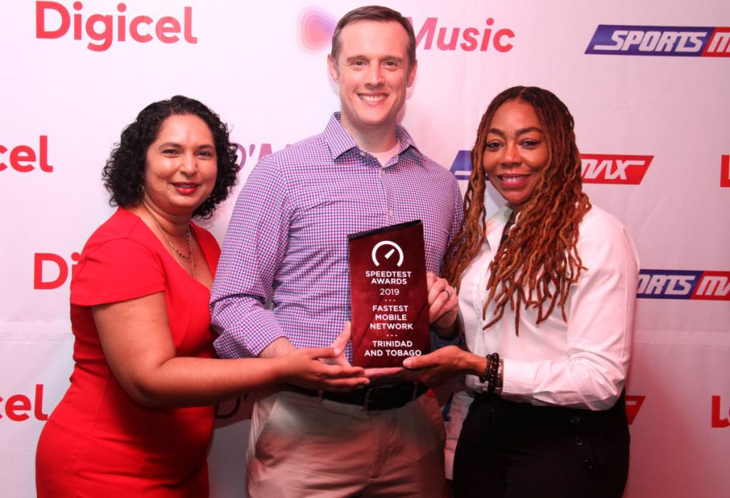 Digicel's head of marketing Trijata Maraj, consumer director Abraham Smith and CEO of the Digicel Foundation Penny Gomez at the launch of the company's Christmas campaign at the Queen's Park Oval on Thursday.  PHOTO BY AYANNA KINSALE - Ayanna Kinsale