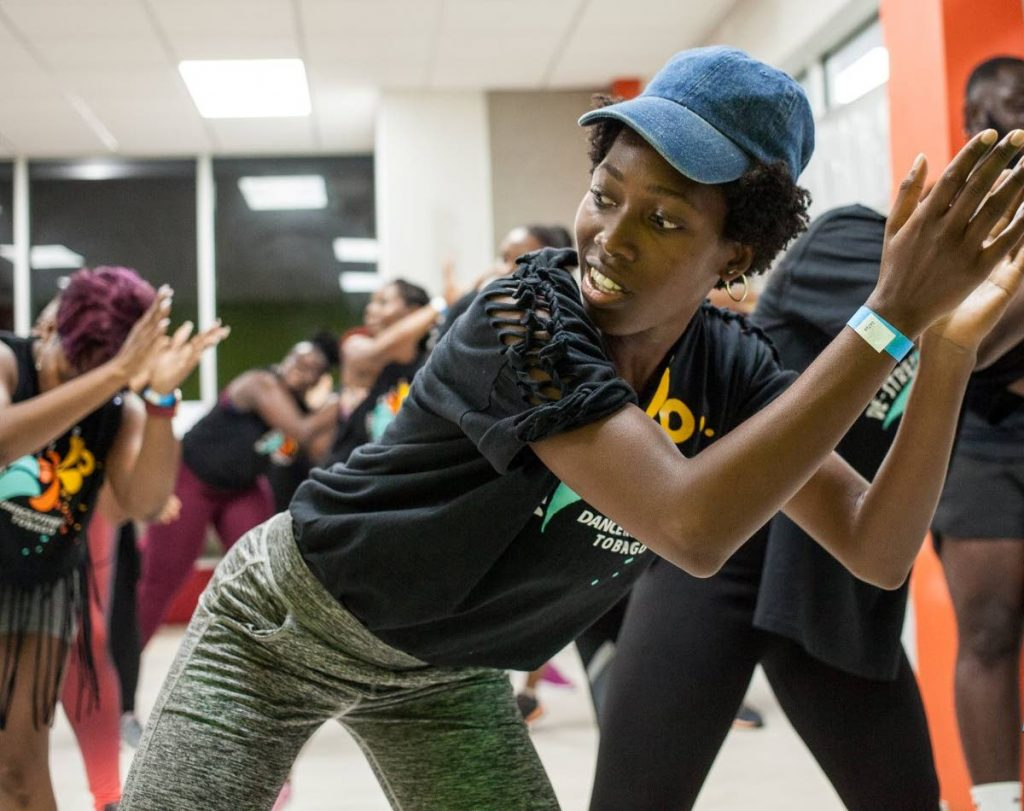 A participant moves to the rhythm at a de-stressing dance fitness event at Port Mall, Scarborough recently.  - Dance Fitness Tobago