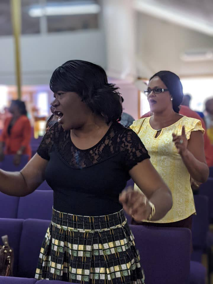 The congregation sings songs of praise during the Division of Tourism, Culture and Transportation's thanksgiving service on Monday at the Good News Seventh Day Adventist Church in Scarborough. - THA